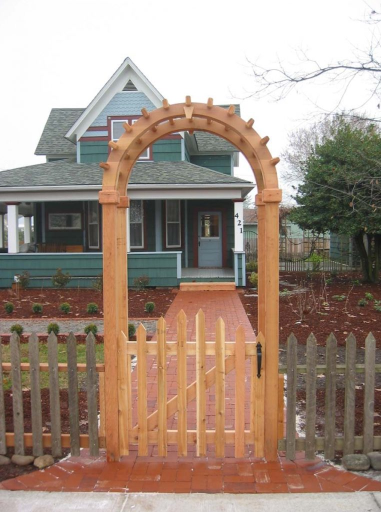 arbor and gate with picket fence landscape