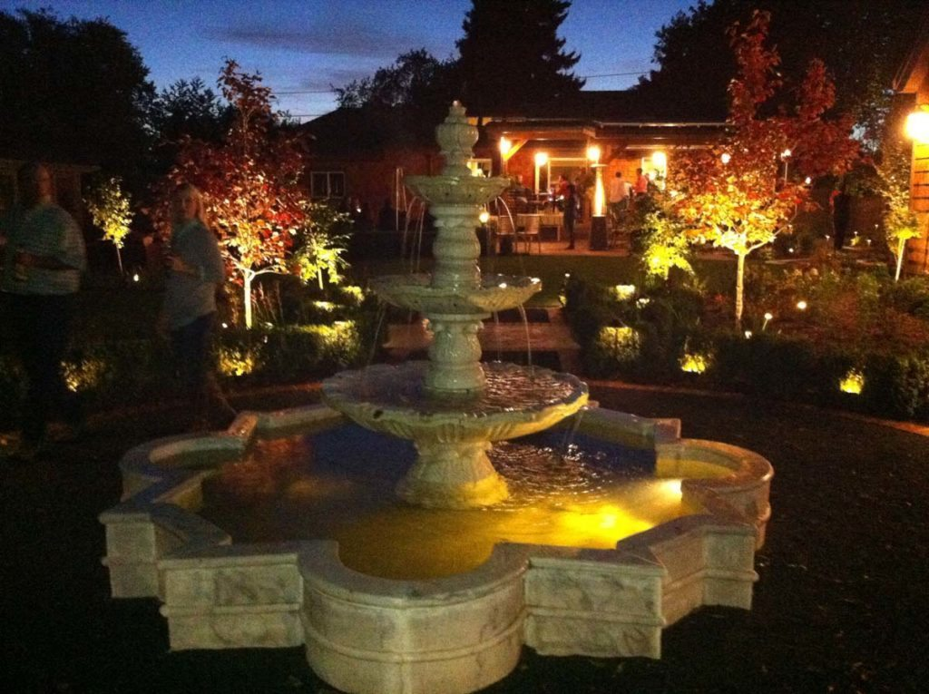 marble fountain and bluestone courtyard landscape lighting