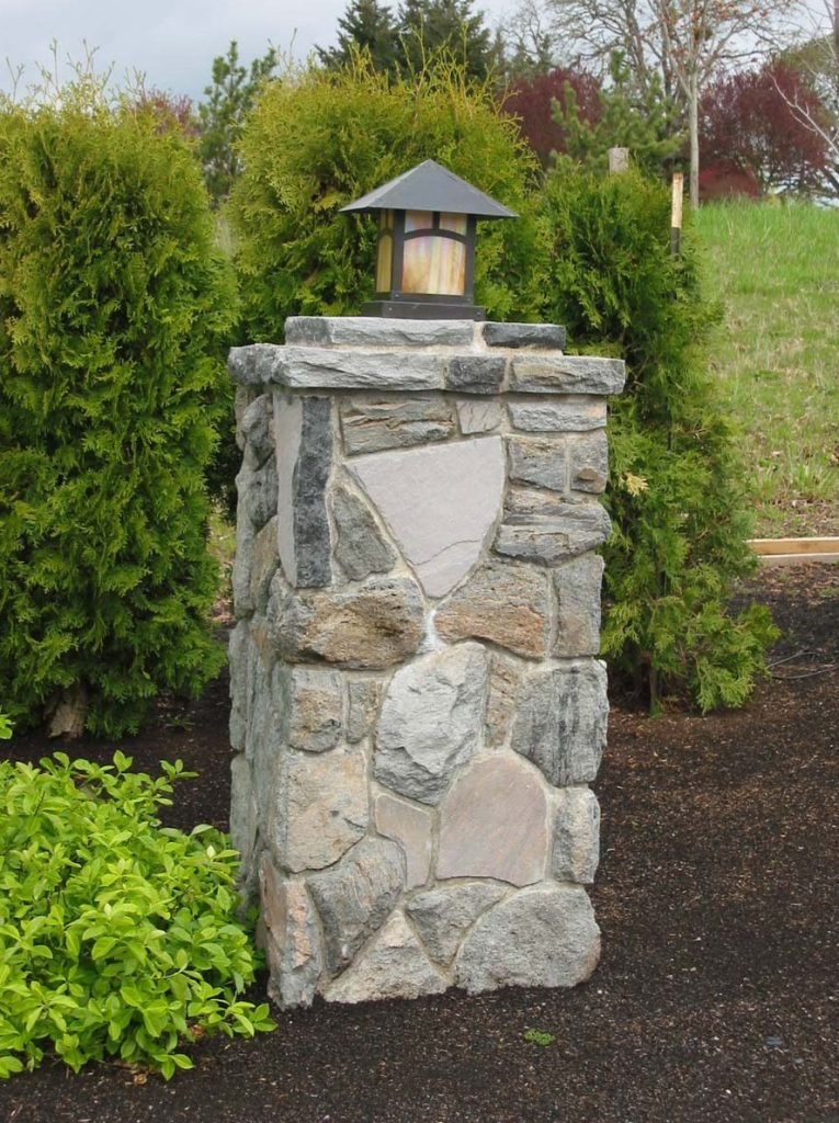 concrete exposed aggregate and rock wall landscape in salem 6