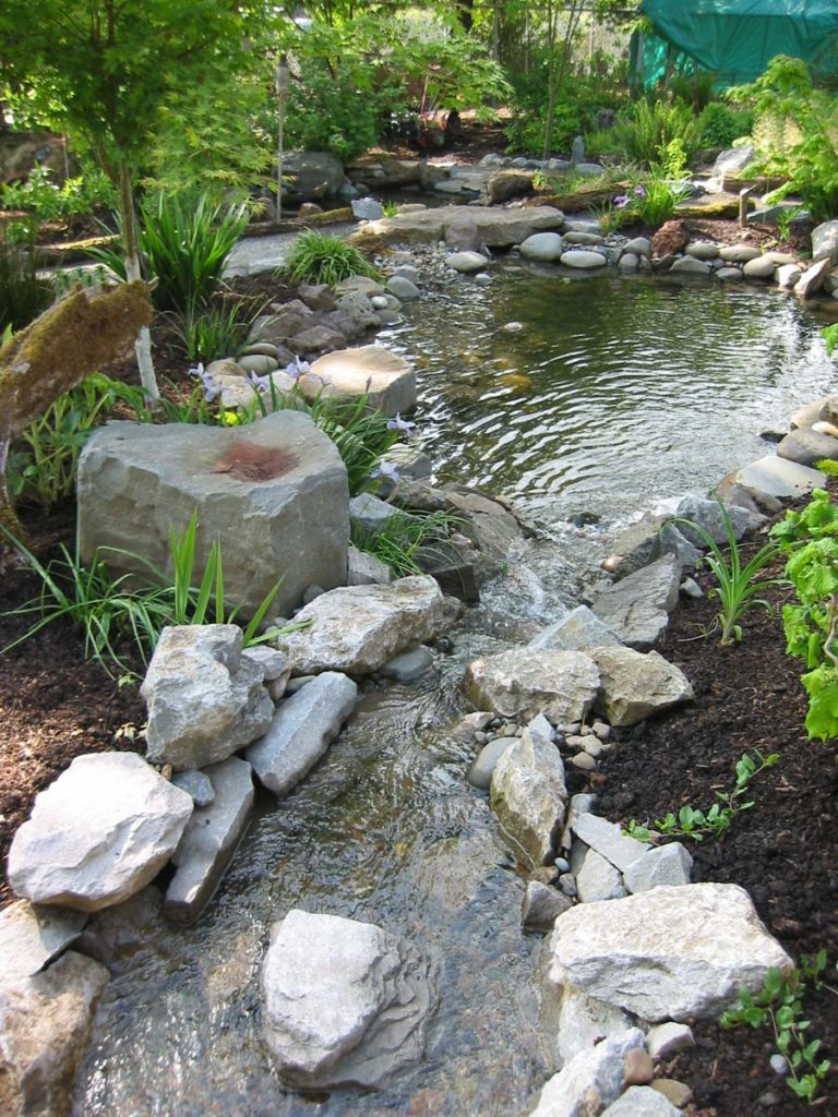 pond with rock column and boulders salem oregon