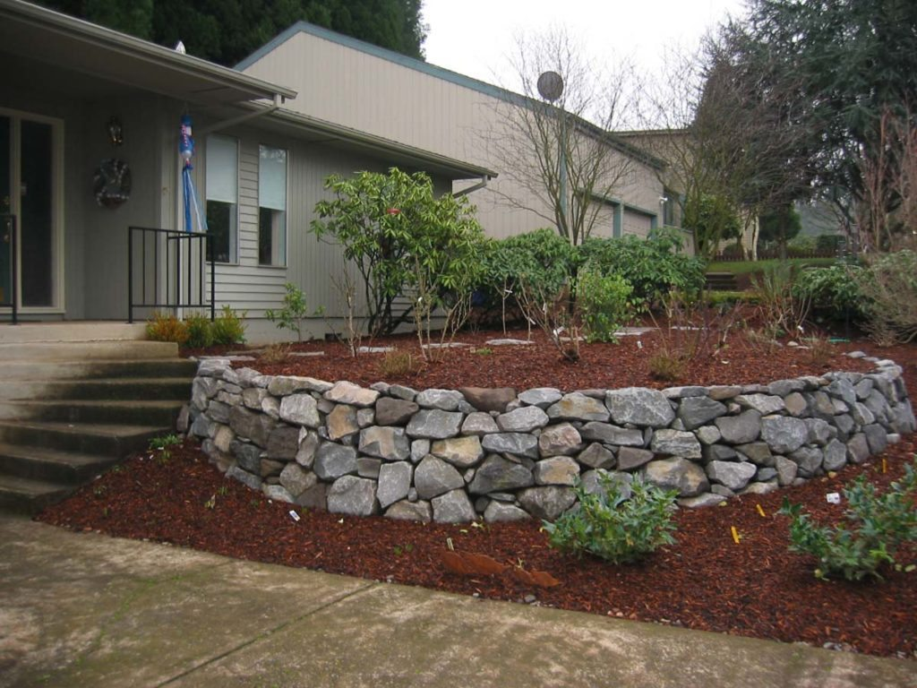 rubble retaining wall with landscape design