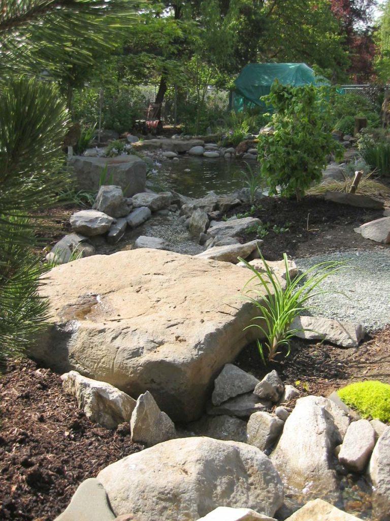 rock slab bridge with pond landscape design