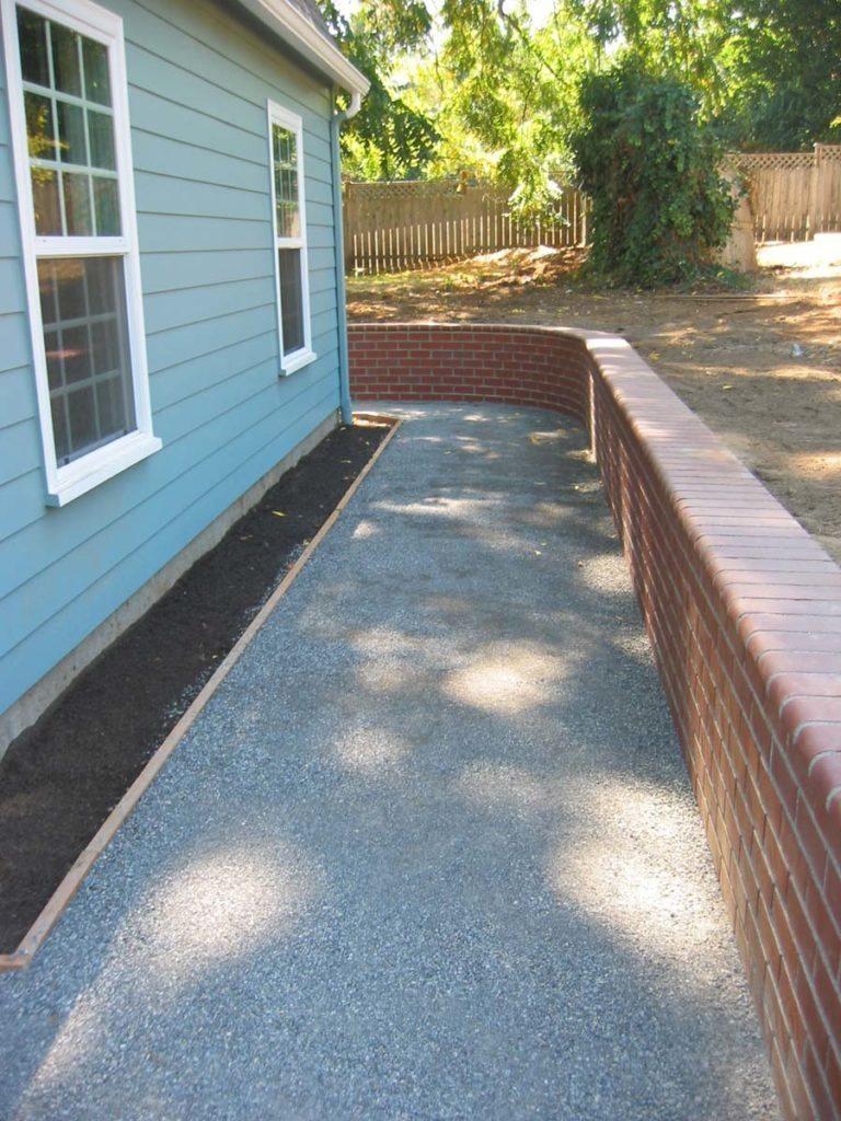 brick retaining wall for walkway landscape design