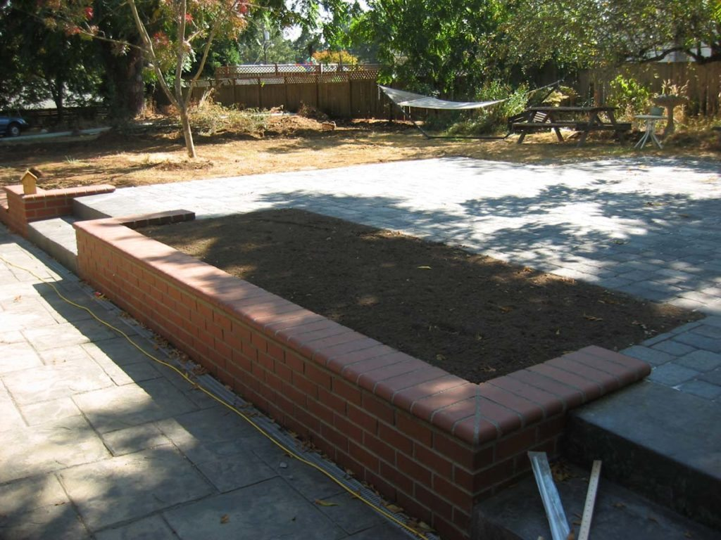 brick seat wall and retainer in landscape design
