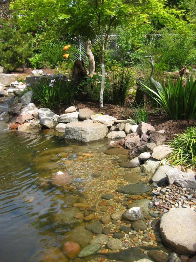 pond with boulders and landscaping salem