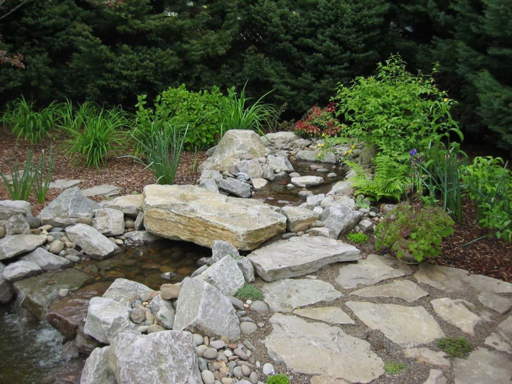 pond with boulders and waterfall landscape design 7
