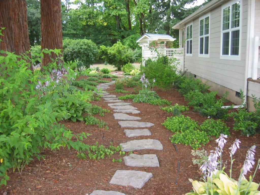 secret garden with perennial border and meandering pathways in salem oregon