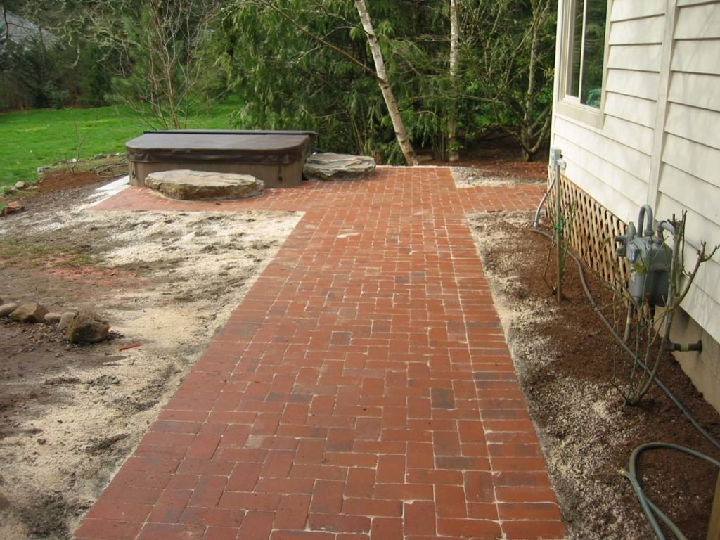 spa tub in ground with slabs and clay brick salem oregon