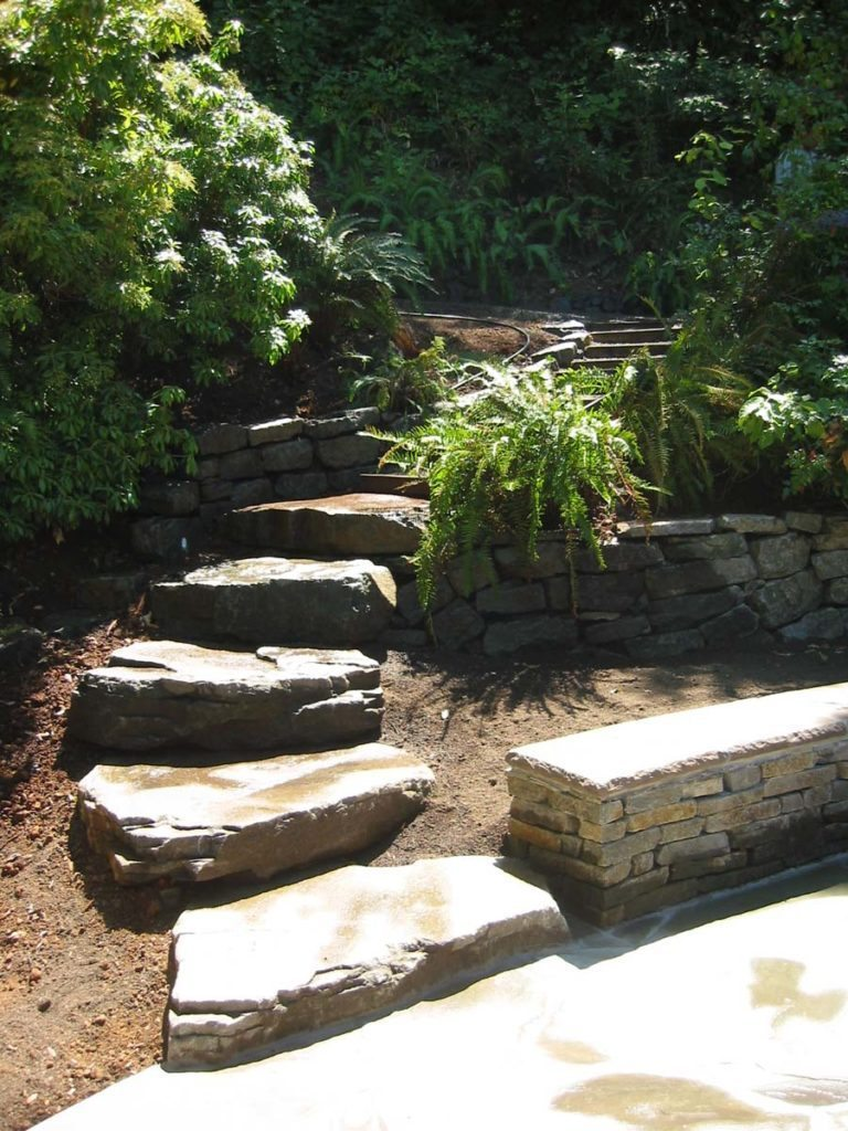 slab steps next to seat wall and rubble wall in landscape design salem oregon