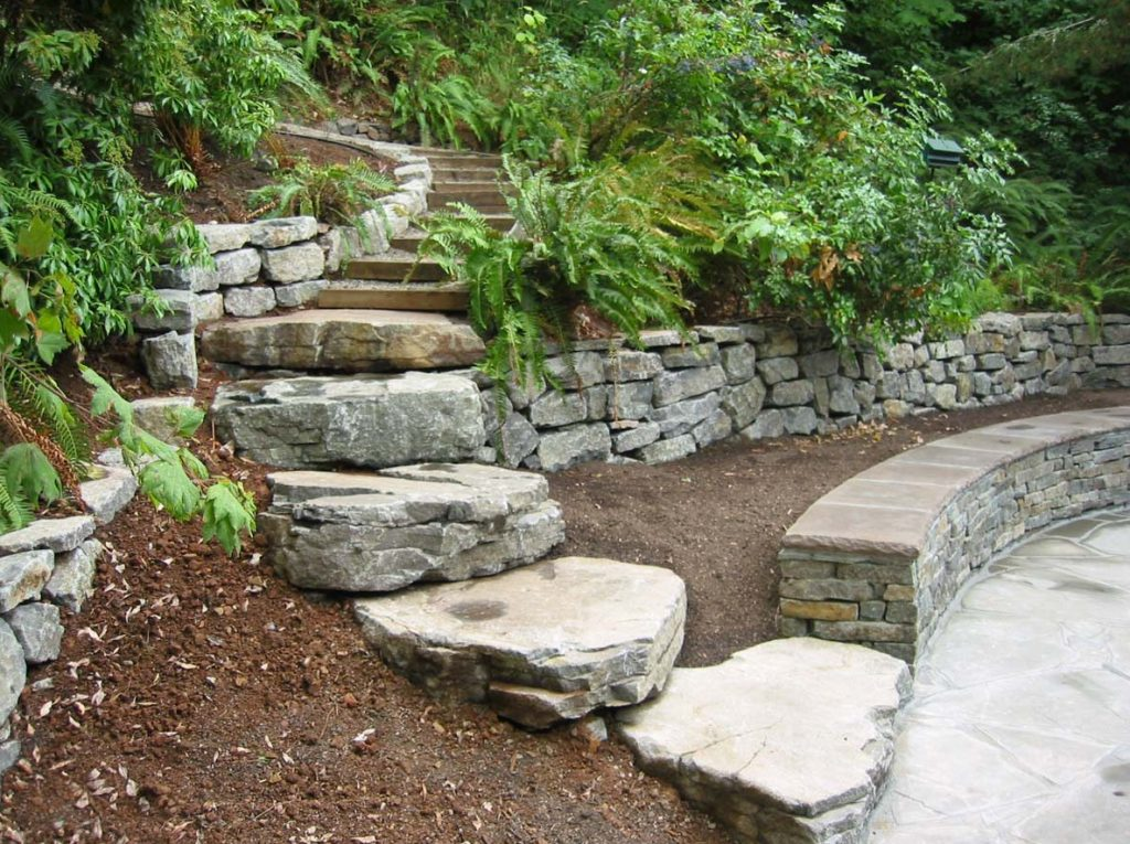 slab steps next to seat wall and rubble wall in landscape design salem oregon 2