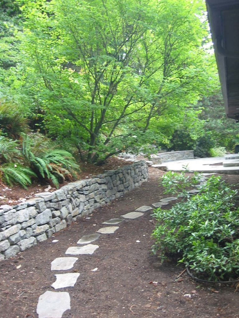 split stone walkway with rubble wall in landscape salem oregon