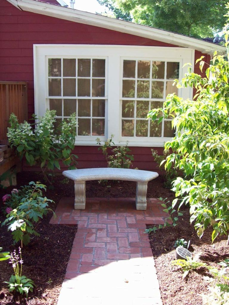 mortared clay brick walkway with bench landscape design
