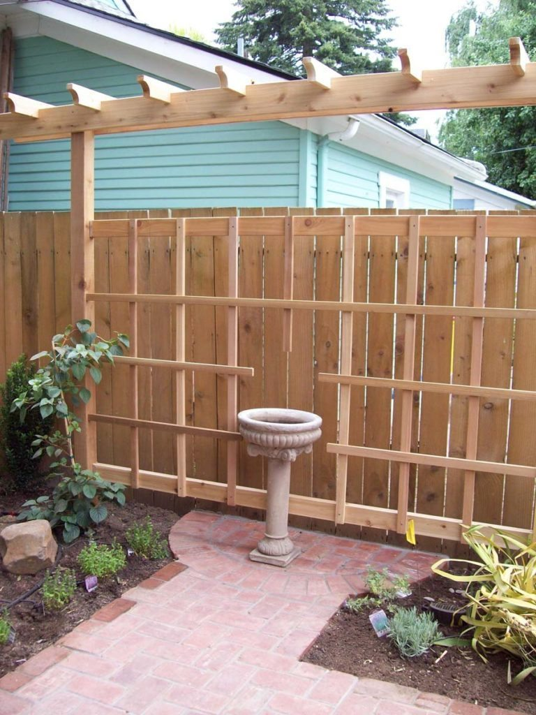 construction of cedar trellis and clay brick pathway landscape design 3