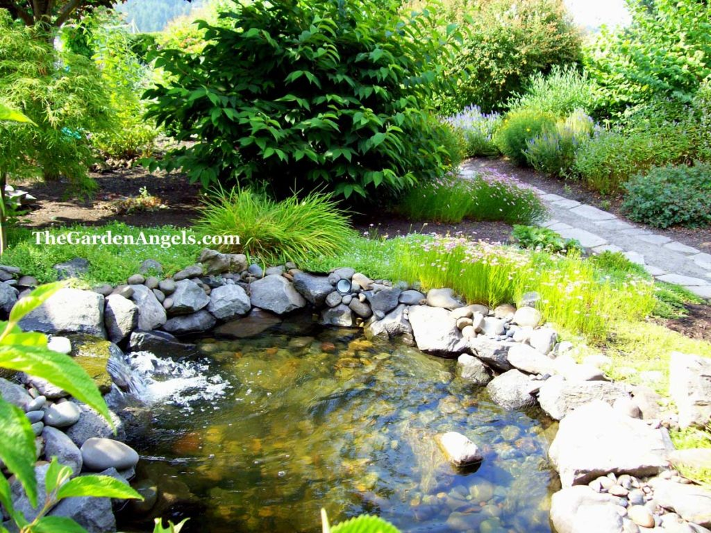pond landscaping and split stone gravel path