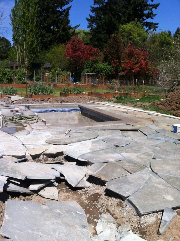 swim spa under construction with bluestone landscape design