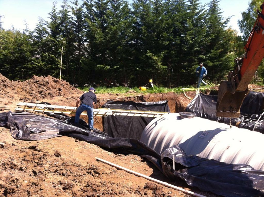 rainwater harvesting tank in landscape