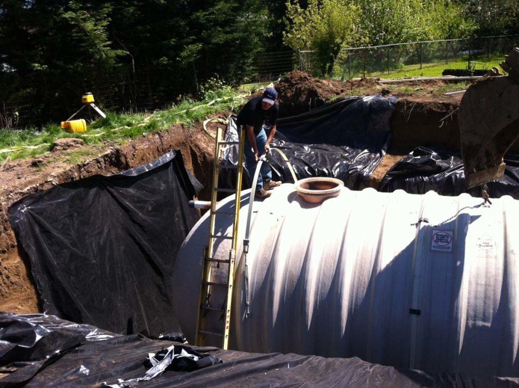 rainwater harvesting tank in landscape 7