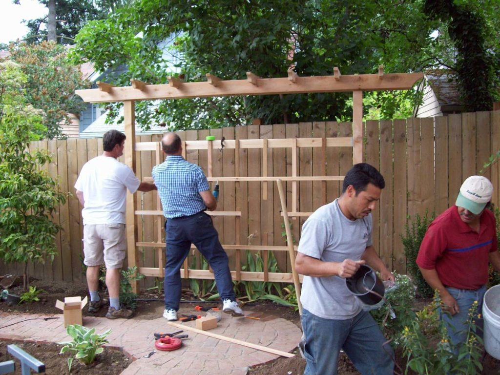 construction of cedar trellis and clay brick pathway landscape design
