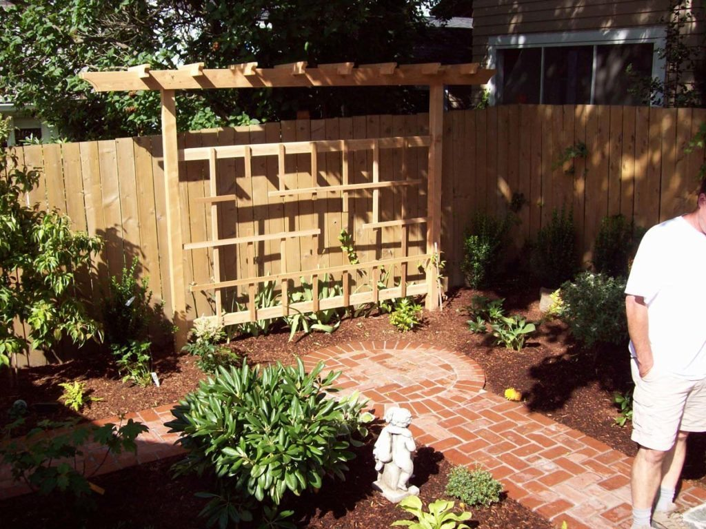 construction of cedar trellis and clay brick pathway landscape design 2