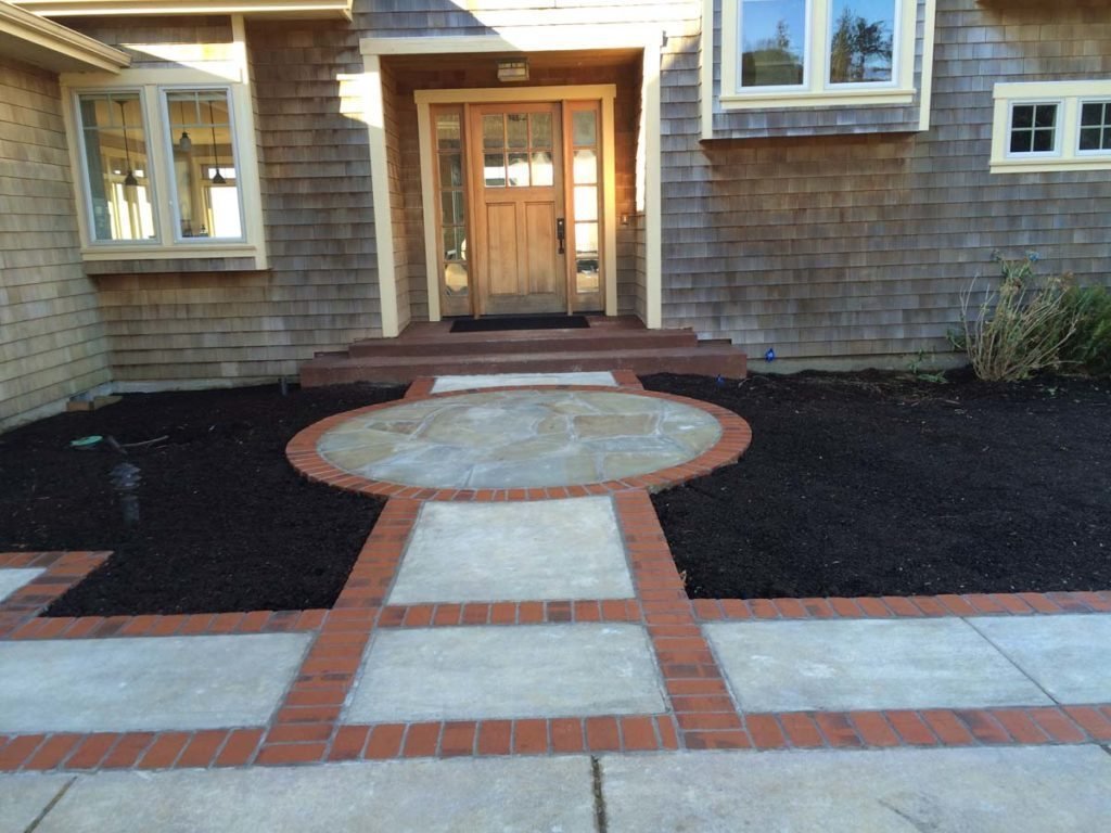 entry greeting space with brick and concrete and pergola landscape design 7