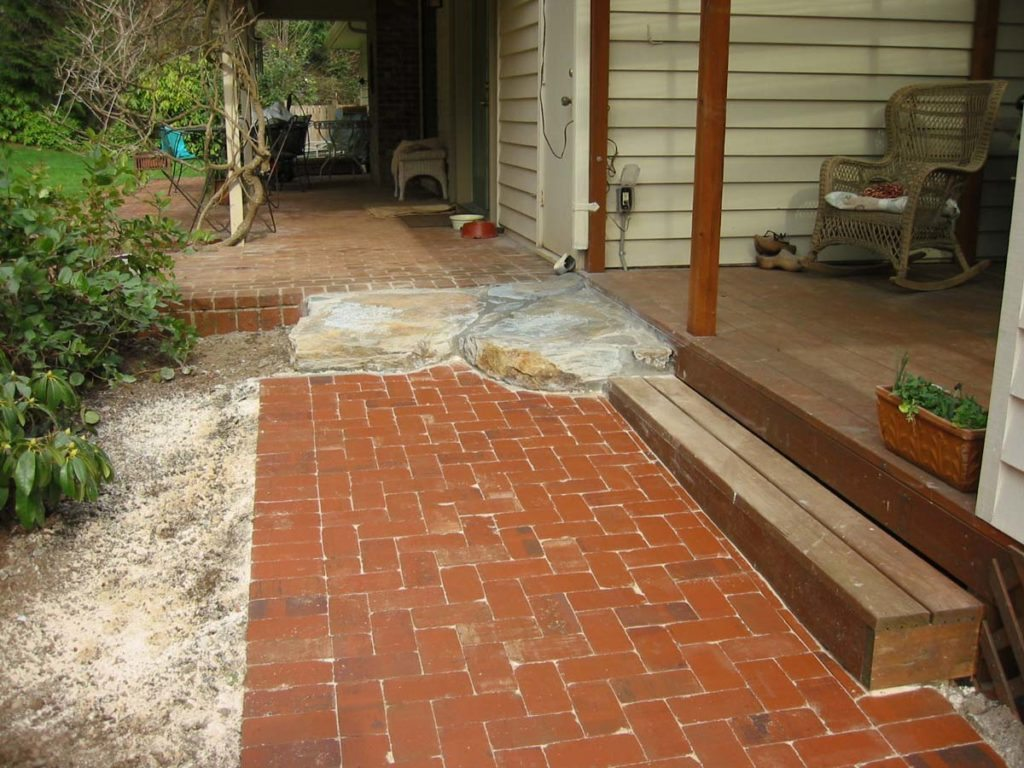 slab stone with clay brick patio design