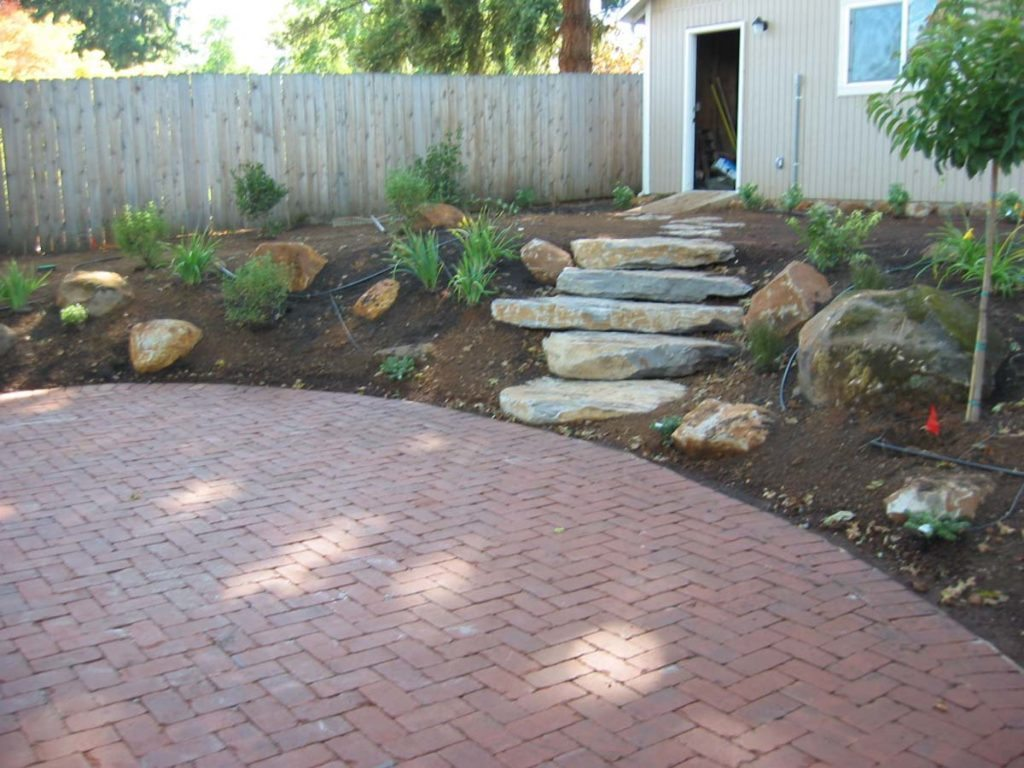 clay brick patio with new and used stone landscape design