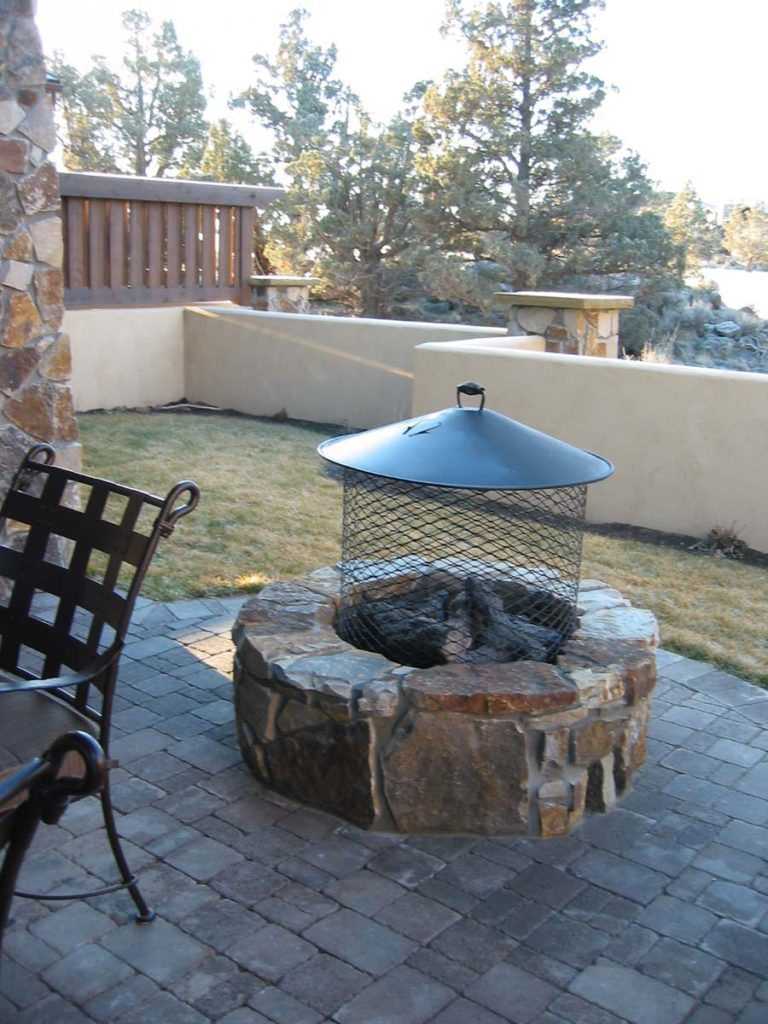 courtyard with concrete brick and fire pit with screen landscape design