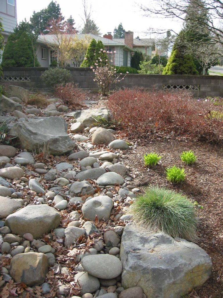 flagstone masonry and boulder seeding with dry creek bed landscape 3