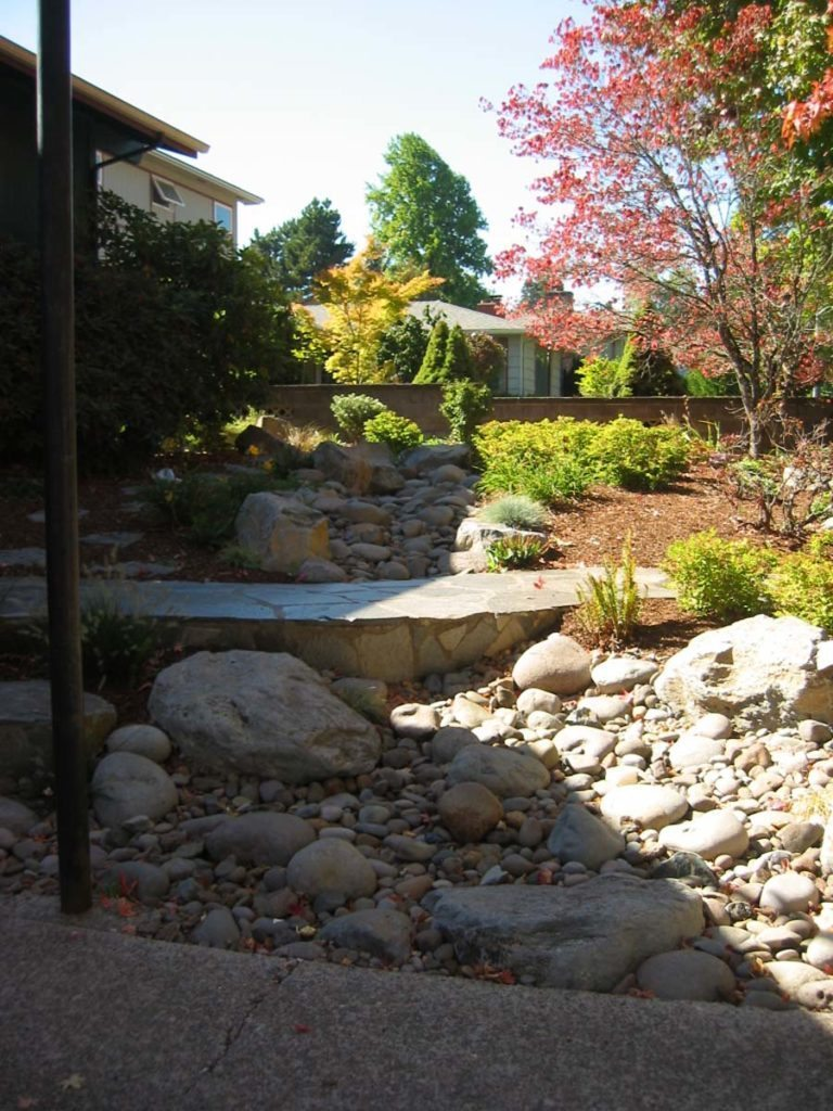 flagstone masonry and boulder seeding with dry creek bed landscape 4