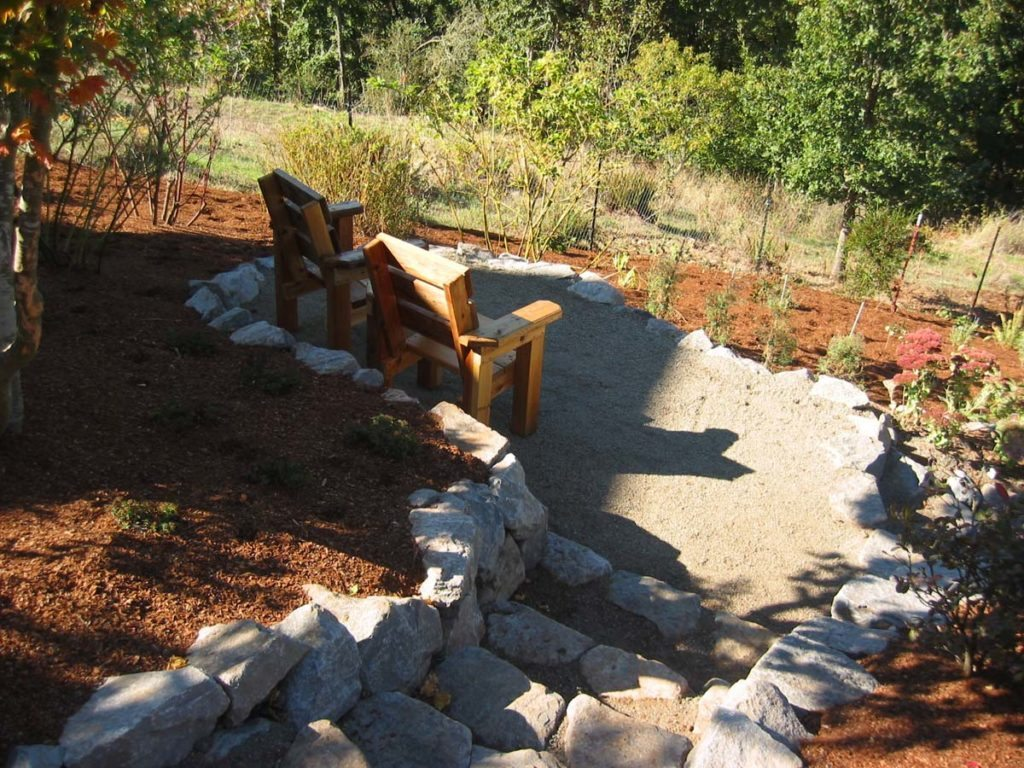 crushed gravel area with stone steps and retaining wall landscape