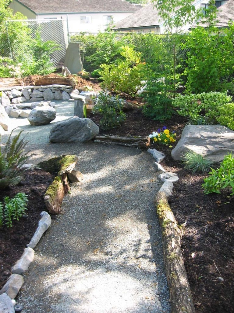 crushed gravel path to fire pit landscape
