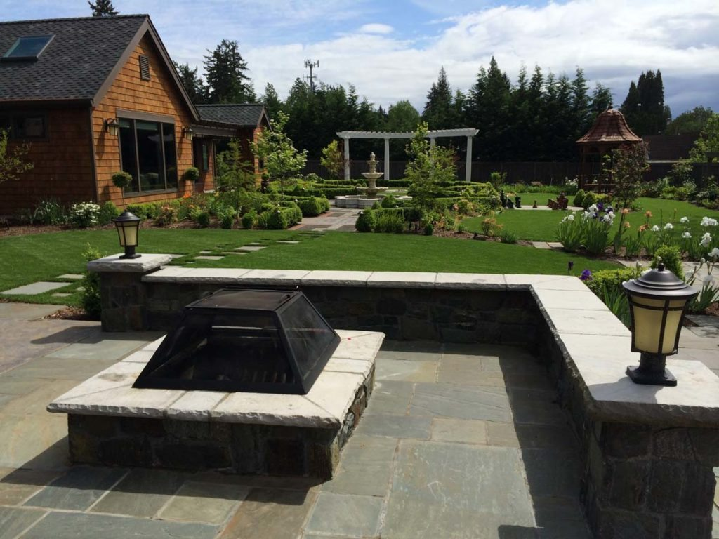fire pit and blue stone seat wall landscape design