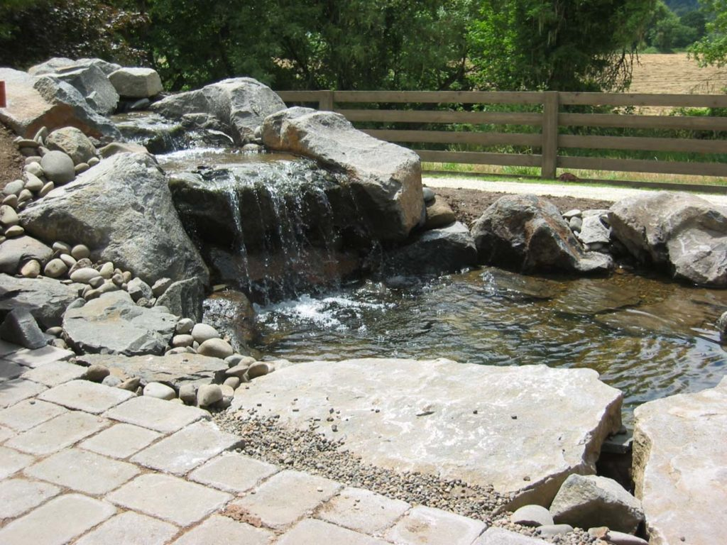 waterfall and water feature with boulders and pond landscape design 5