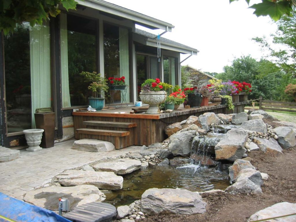waterfall and water feature with boulders and pond landscape design construction 2