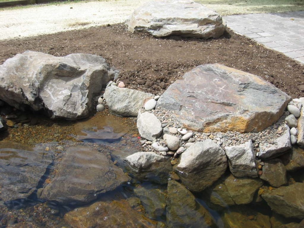 waterfall and water feature with boulders and pond landscape design 4