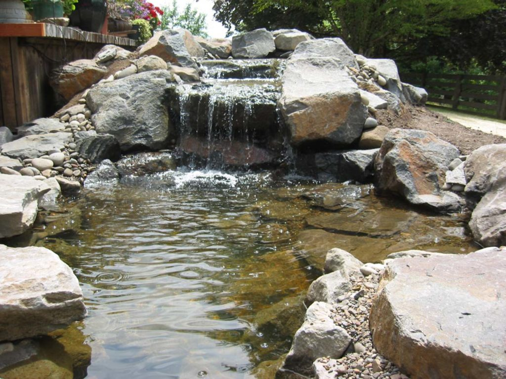 waterfall and water feature with boulders and pond landscape design 3