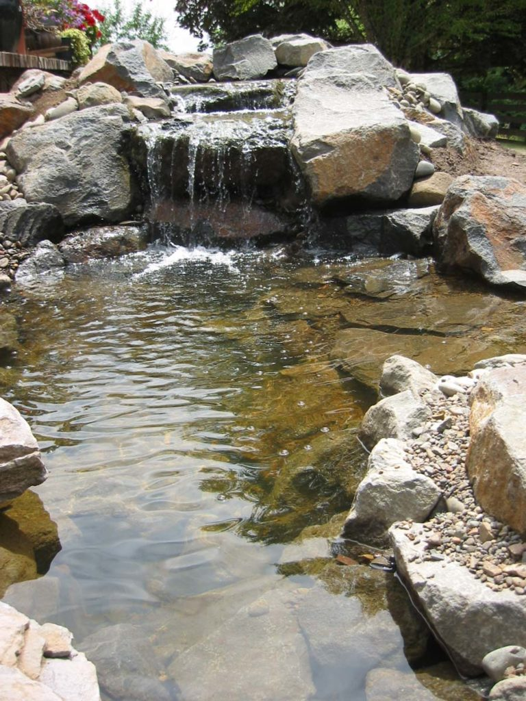 waterfall and water feature with boulders and pond landscape design 8