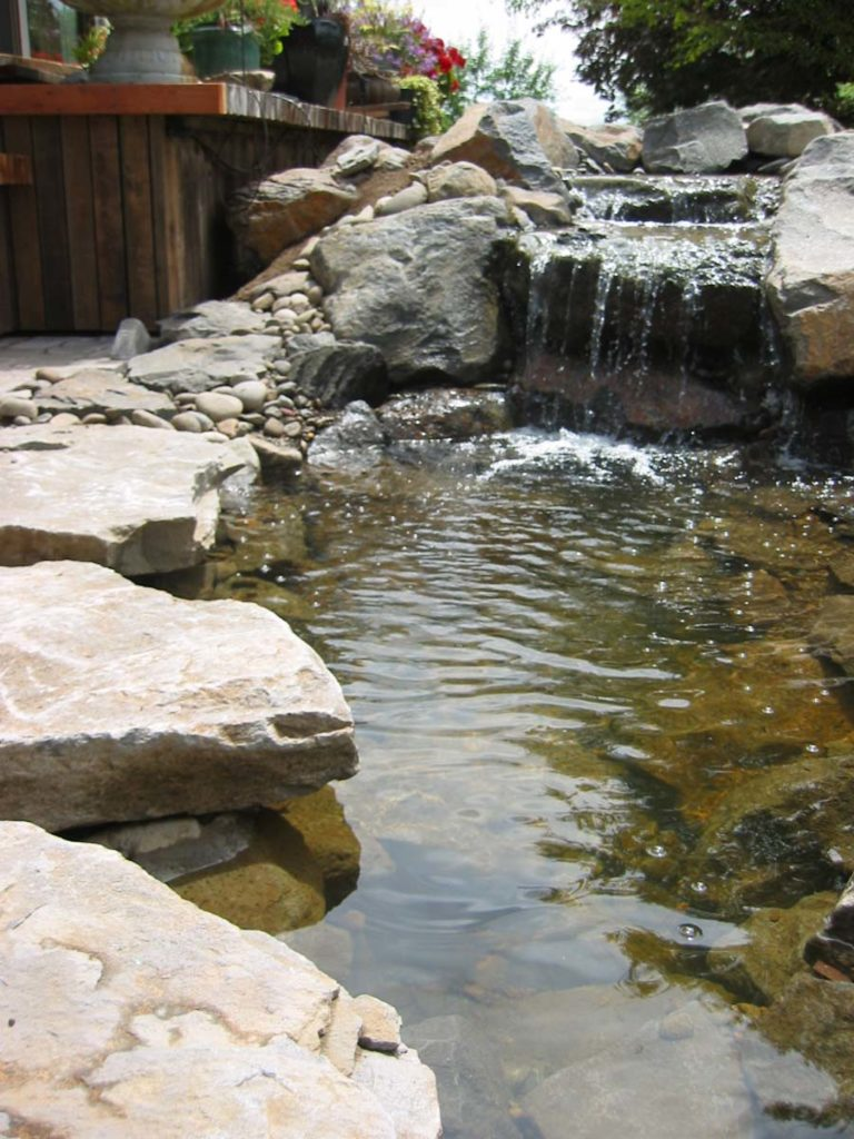 waterfall and water feature with boulders and pond landscape design 7