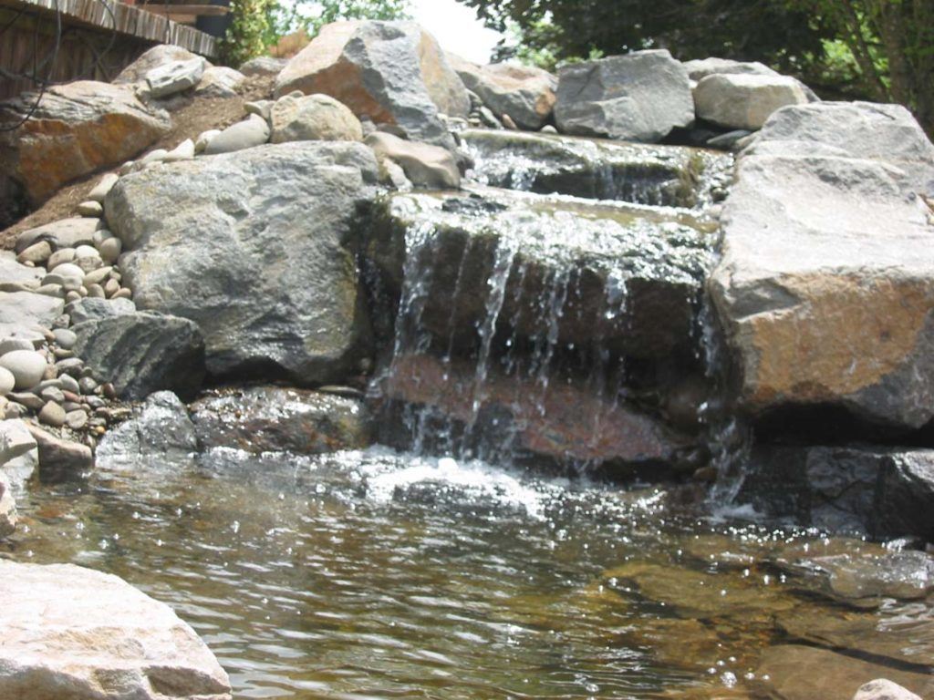 waterfall and water feature with boulders and pond landscape design 6