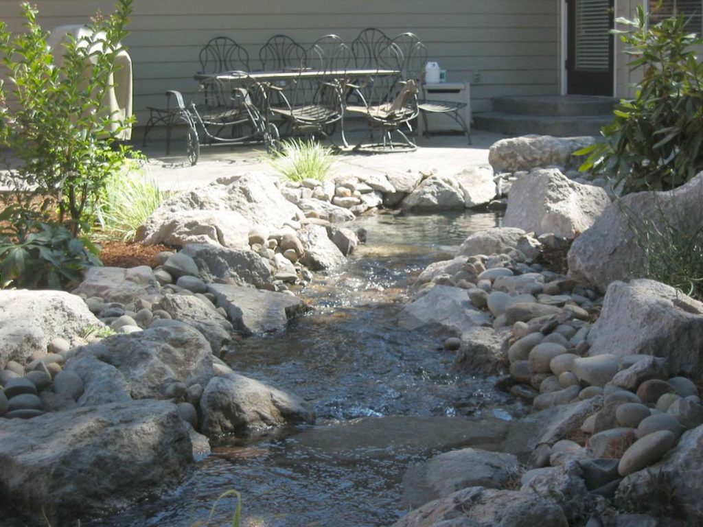new pond with water feature and fish in salem oregon 7