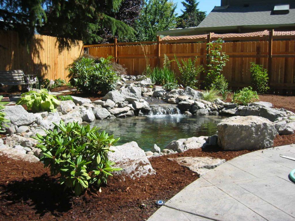 pond with water and boulder seeding landscape salem oregon