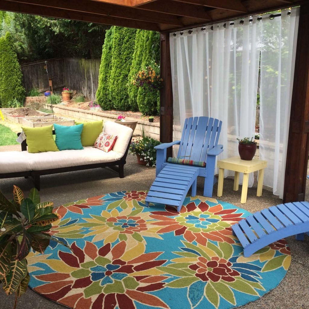 outdoor living with rugs and curtains in landscape