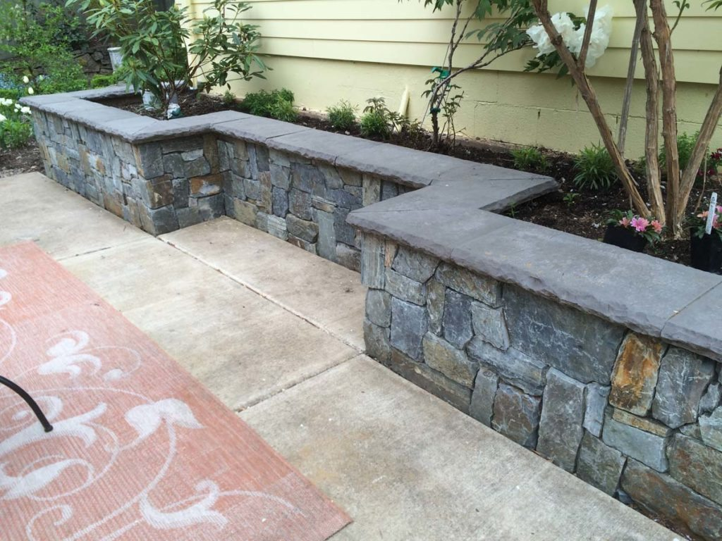 seat wall and planter area in couryard landscape design