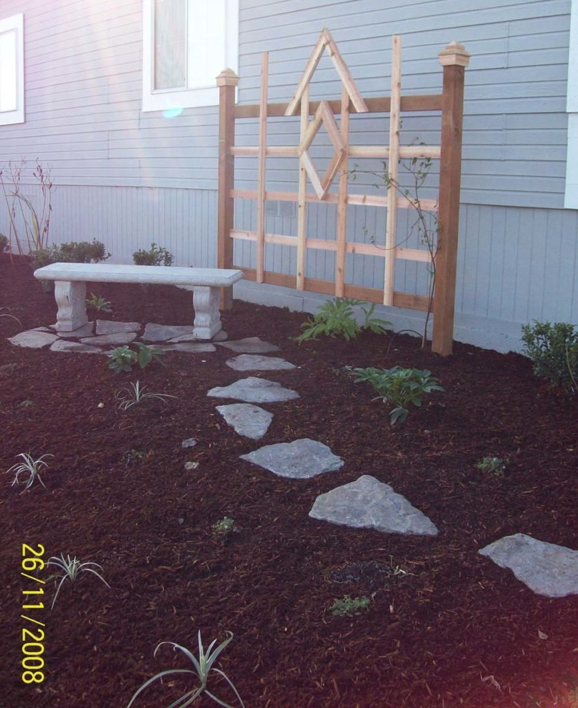 cedar trellis with bench and split stone walkway in salem oregon 2