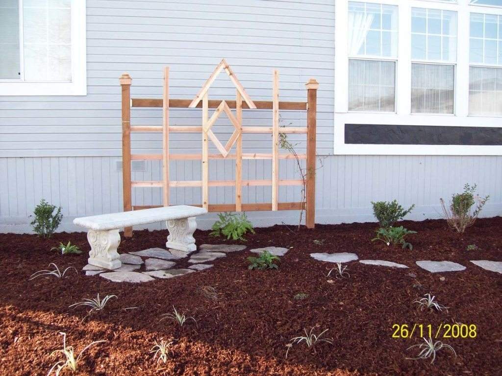 cedar trellis with bench and split stone walkway in salem oregon