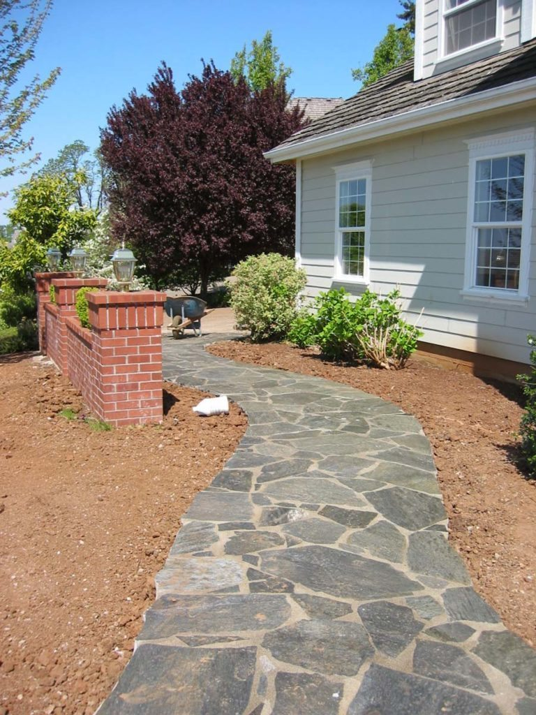 mortared flagstone pathway with brick wall in salem oregon
