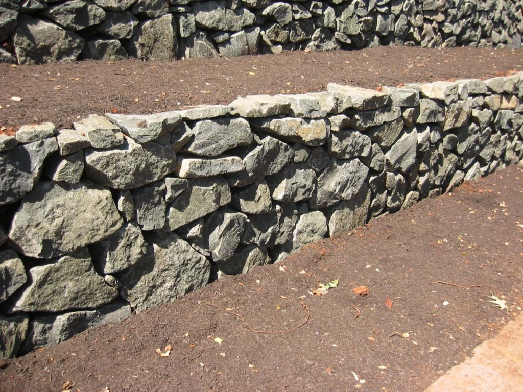stackstone retaining wall in landscape design