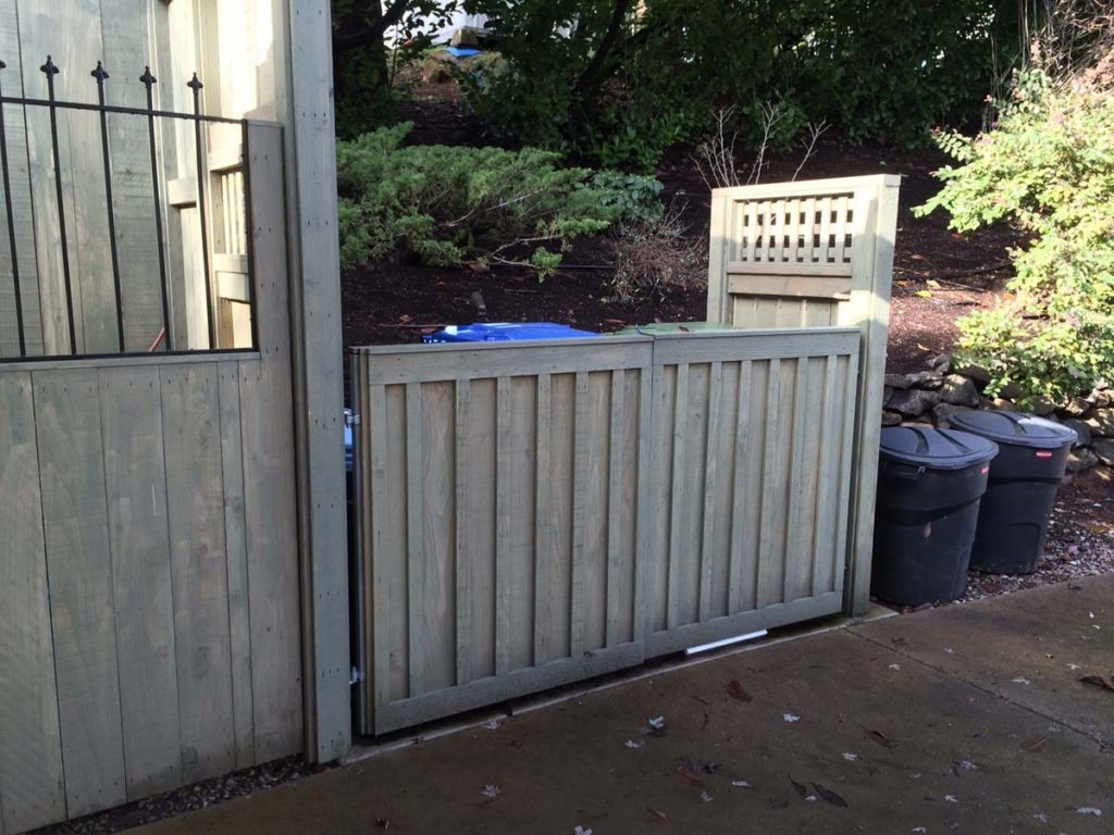 refuse can storage behind custom gates landscape design 2
