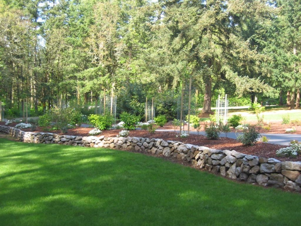 stackstone wall with lawn in landscape design