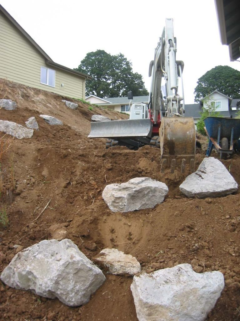setting boulders at landscape project salem